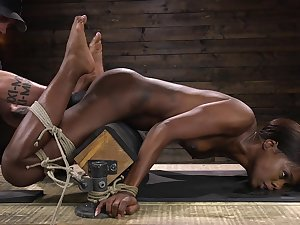 Affianced sylphlike black nympho Ana Foxxx is gagged and masturbated