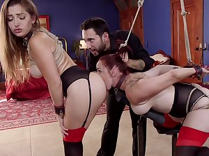 Bound Dani Daniels and Bella Rossi shelter as mating slaves for invidious Master