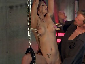 Sub is bound with handcuffs while Master shoves toys round her cunt