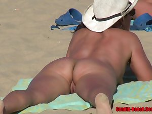 Naked wholesale is enjoying primarily the beach while people are staring at her trimmed pussy