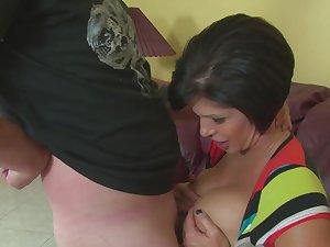 Shapely mature dame Shay Fox titty fucks and gives three hell of a handjob