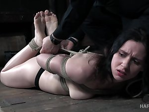 Tied up Audrey Holiday gets her pussy toyed in make an issue of dark BDSM parade-ground