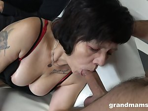 Two sex-starved guys fuck mouth and pussy of hustler granny in overheated stockings